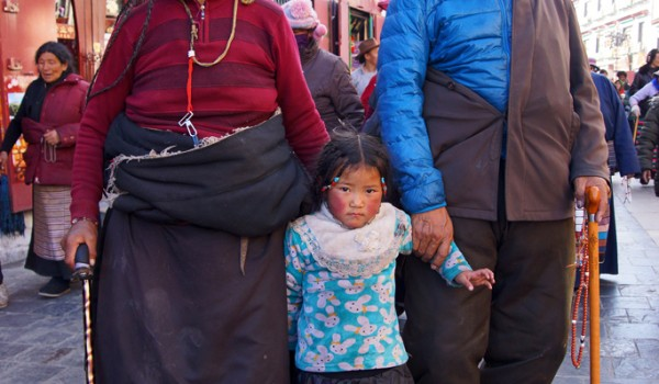 Lhasa: a couple with their granddaughter at Barkhor Street