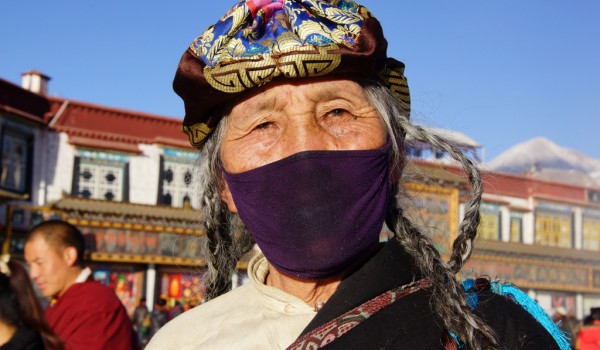 Lhasa: portrait of a pilgrim at Barkhor Square
