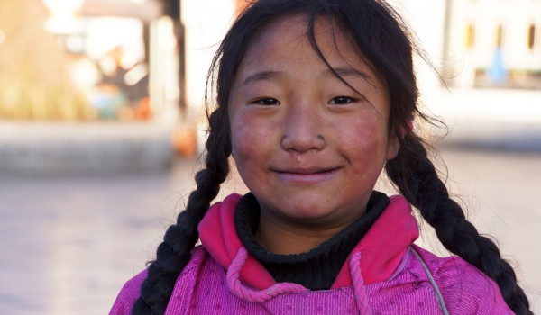 Lhasa: portrait of a young girl at Barkhor Square