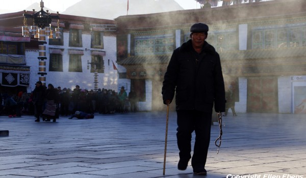 Lhasa: pilgrim at the Jokhang Temple on a cold winter day