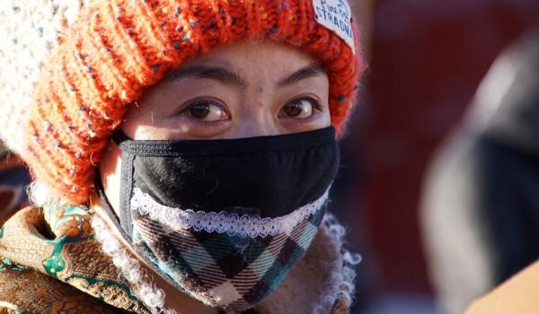Lhasa: young woman at Barkhor Street