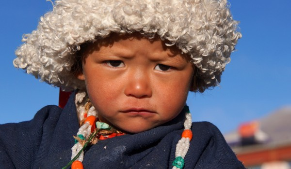 Lhasa: portrait of a beautiful little boy at Barkhor Square