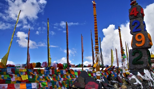 Prayer flags on a high pass (4,292 meters) on the way from Shangri-La to Deqin, Yunnan