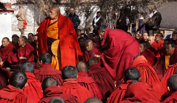 Special ceremony at Sera Monastery, Lhasa: the baktsamaku (discipline monk) walking round while burning incense is lit