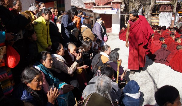 Special ceremony at Sera Monastery, Lhasa: clearing a path for the entry of the monk, who passed the highest exams