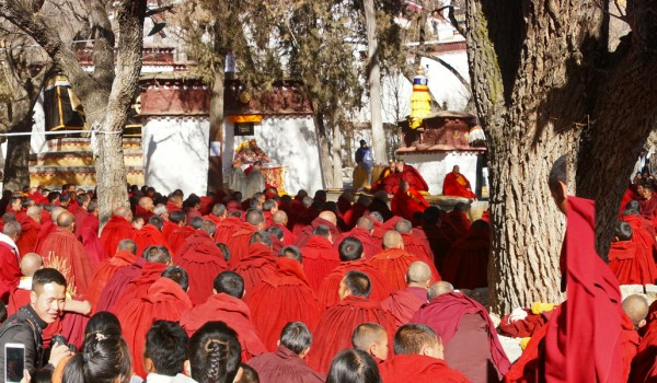 Special ceremony at Sera Monastery, Lhasa: monks and public watching the ceremony