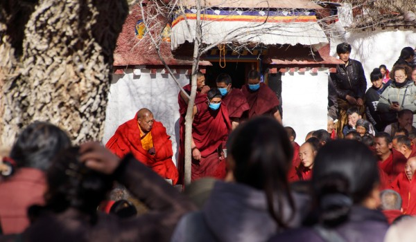 Special ceremony at Sera Monastery, Lhasa: monks bringing in the food