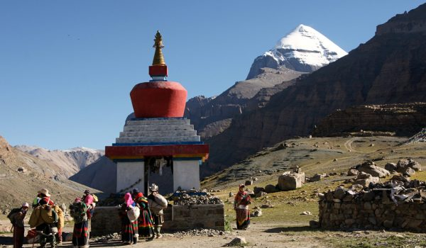 Day 1 of the kora: pilgrims at the Kangnyi Chörten at the beginning of the Lha-chu Valley with behind it the south face of Mount Kailash (2010)