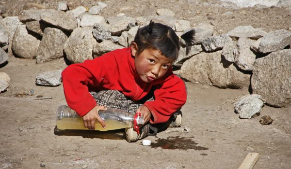 Day 1 of the kora: a girl playing at the guesthouse beneath the the north face of Mount Kailash, she lives here with her family during the kora season (2011)