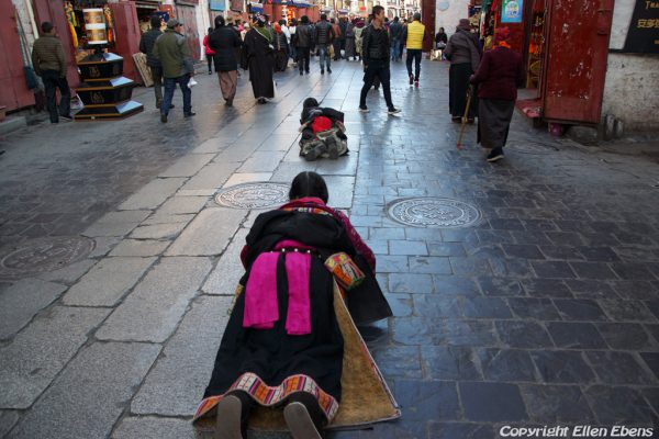 Lhasa: pilgrims prostrating at the Barkhor