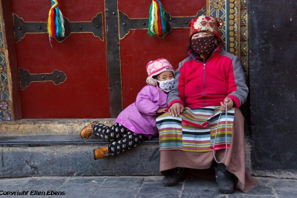 Lhasa: a grandmother and her grandchild at the Barkhor