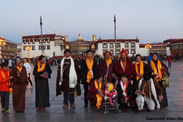 Lhasa: a family posing in front of the Jokhang Temple