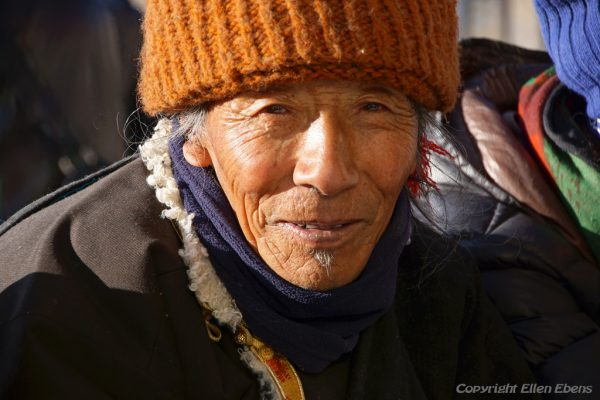 Lhasa: portrait of a pilgrim at Drepung Monastery