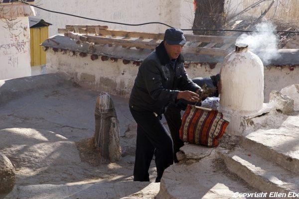 Lhasa: pilgrims burning juniper at Drepung Monastery