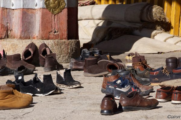 Lhasa: shoes of the monks at the entrance of the Main Assembly Hall of Drepung Monastery