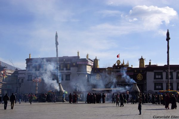 The Jokhang Temple in the old city of Lhasa with juniper incense burning