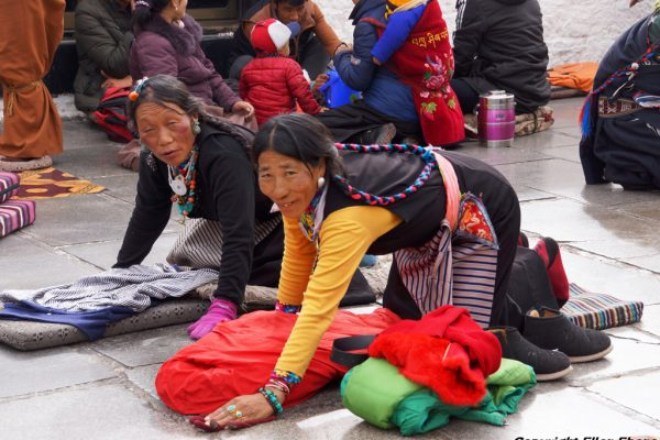 Lhasa: two women prostrating in front of the Jokhang Temple