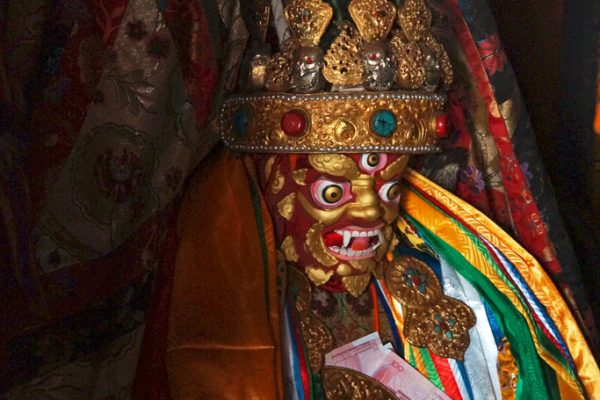 Lhasa: satue of a protector at Meru Nyignba Monastery, situated behind the Jokhang Temple