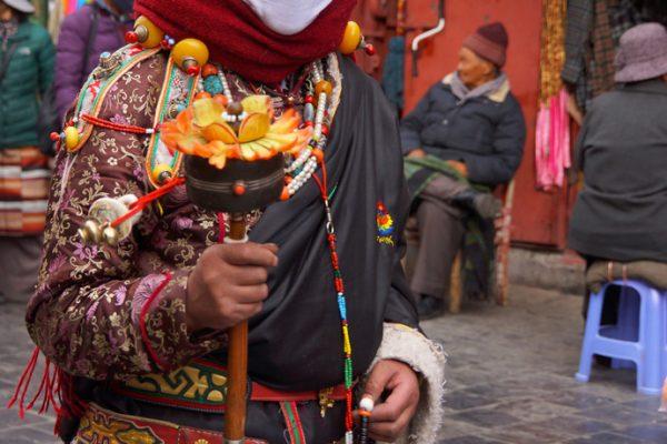 Lhasa: pilgrim walking the Barkhor