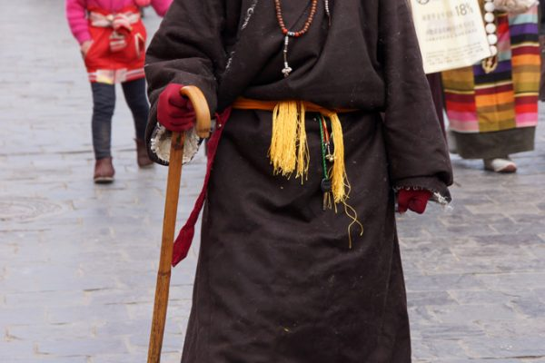Lhasa: a woman walking the Barkhor