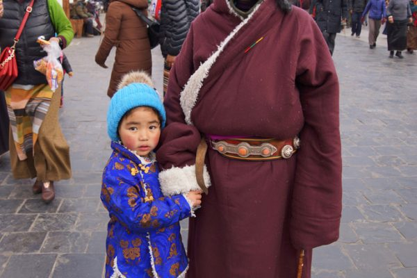 Lhasa: mother and young child at the Barkhor