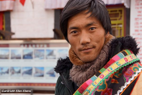 Lhasa: portrait of an young man at the Barkhor