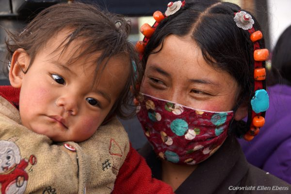 Lhasa: mother with her young child at the Barkhor