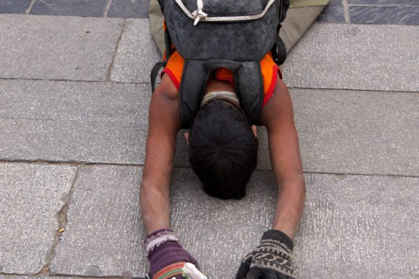 Lhasa: prostrating young pilgrim at the Barkhor
