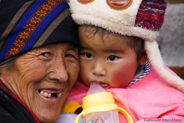 Lhasa: a grandmother with grandchild at the Barkhor