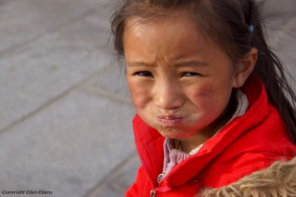 Lhasa: portrait of a young girl at the Barkhor