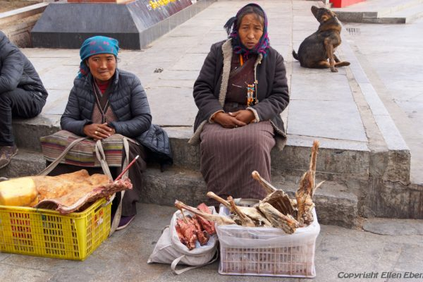 Lhasa: street vendors with meat at Barkhor Square