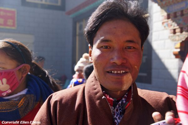 Portrait of a pilgrim waiting for hours at Yasang Monastery for the water blessing. Yasang Monastery (in the valley behind Tsedang)