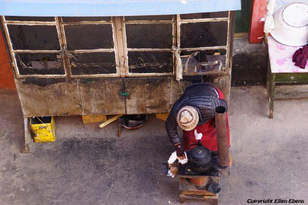Lhasa: a busy nun at Chubzang Nunnery