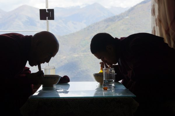 Monks having lunch in the restaurant of monastery high above the town of Guanyinqiao