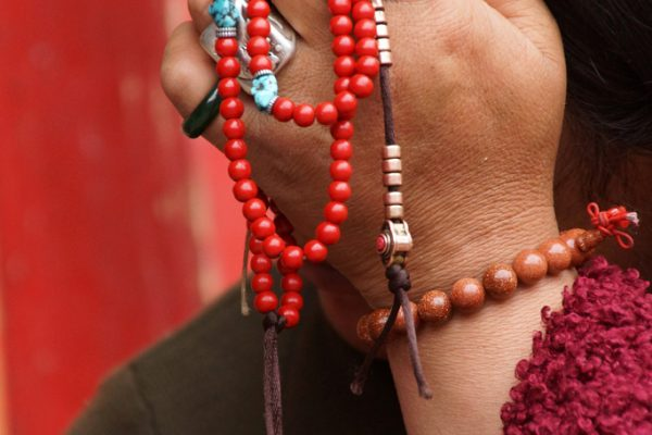 Woman pilgrim with her mala