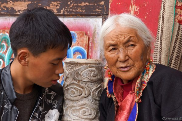 Older lady with her grandson at at the monastery high above the town of Guanyinqiao