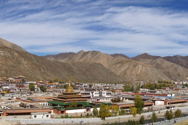 Xiahe: view on Labrang Monastery and the big guilded stupa from a hill