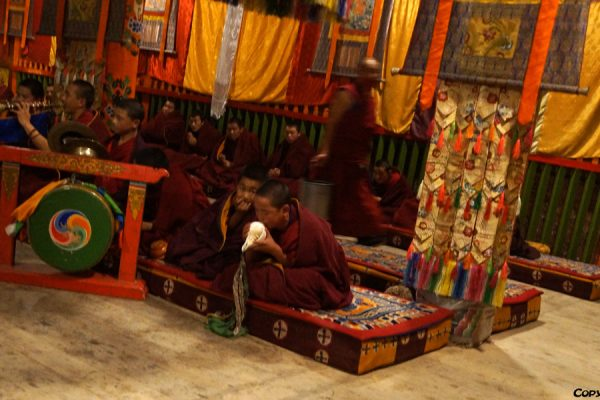 Xiahe: monks at one of the halls at Labrang Monastery