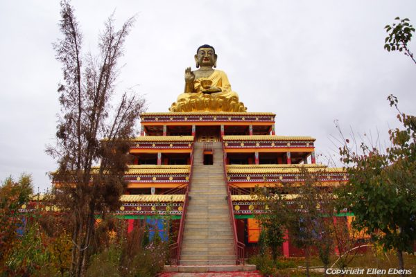 Buddha statue at the top of a stupa at Wutun Monastery, Rebkong (Tongren)