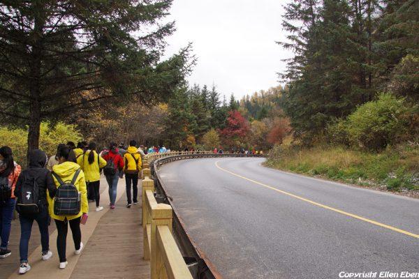 Visitors walking in Jiuzhaigou National Park