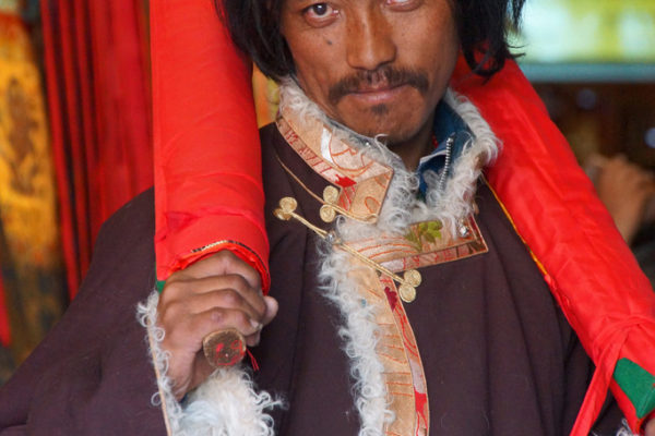 Lhasa, this Tibetan man bought some thankas in a shop at Barkhor Street
