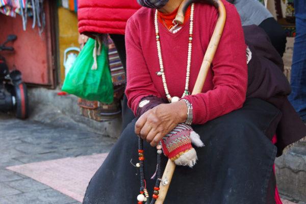 Lhasa, pilgrim resting at Barkhor Street
