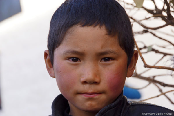 Lhasa, portrait of a boy at Barkhor Street