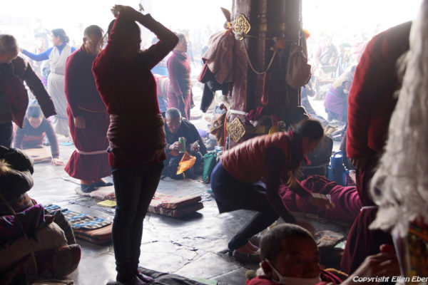 Lhasa, prostrating pilgrims at the entrance of the Jokhang Temple