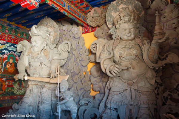 New statues of the guardian Kings at the entrance of Zhatang Monastery. The statures still have to be painted