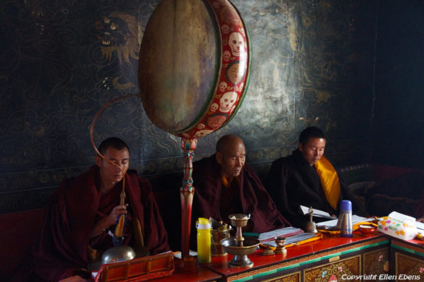 Monks chanting in a chapel on the second floor of the temple at Zhatang Monastery