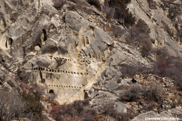 Religious carvings in the rock of mountain slope at Densatil Monastery