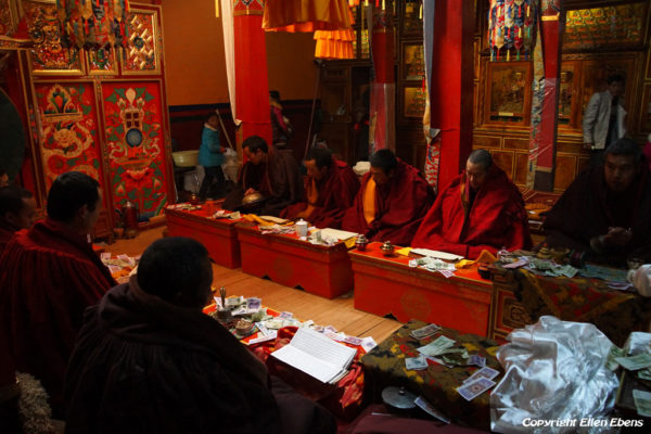 Monks chanting in the Ganden Lakhang hall at Pelkor Chöde Monastery