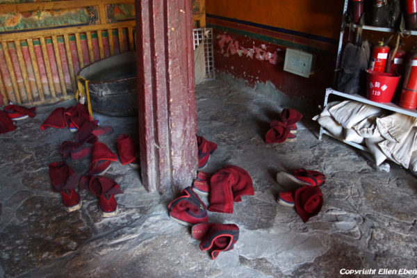 Monks shoes at the entrance of the assembly hall at Shalu Monastery