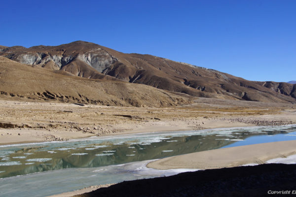Driving from Shigatse through a beautiful valley with the Yarlung Tsangpo river to Puntsholling Monastery
